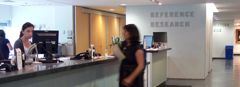 Image of the circulation desk on the main floor where users sign out library materials.